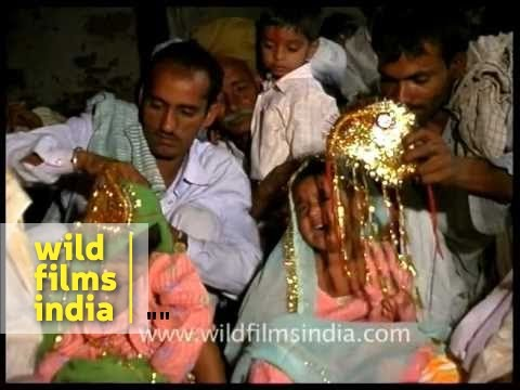 Very small child forced to get married in Mass Child marriage ceremony!