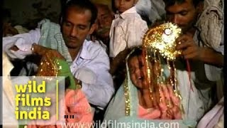 Very small child forced to get married in Mass Child marriage ceremony