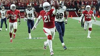 Arizona cardinals cornerback patrick peterson shows off his hand-eye coordination as he tips an austin davis pass to himself and then takes it the house i...