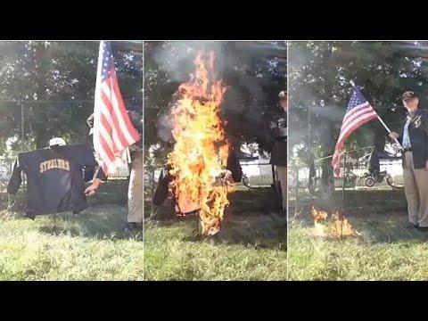 Steelers fan burns jersey while waving American flag