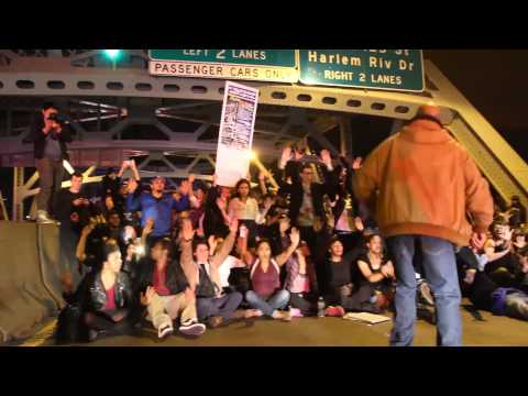 Protesters sit in on the Triborough Bridge
