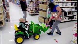 Riding John Deere toy tractor in walmart for kids