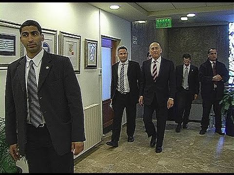 """Israeli Prime Minister """"Ehud Olmert """"surrounded by security guards"""