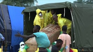 Sierra Leone begins mass burials for the victims of devastating flo...