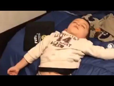 Kid literally falls asleep standing up