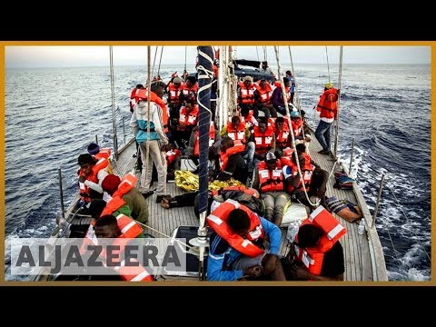Desperate journeys: Migrant rescue boat docks in Italy, defies ban