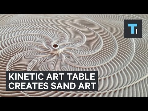 Table that creates sand art with marble that rolls by itself