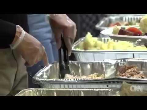 Obama serves meal with Turkey at Washington DC church on Wednesday.