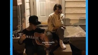 Justin Bieber and Selena Gomez singing on the threshold of a house in Los Angeles, Ca