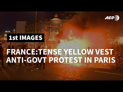 Fires, tear gas and arrests after yellow vest protest in Paris | AFP