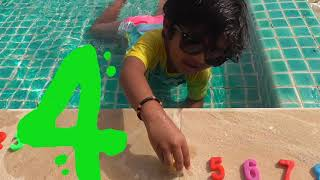 Little Kid enjoying in a big Pool and LEARNING Numbers