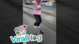 Girl's Shoes Stuck to Racetrack    ViralHog