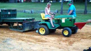 Garden tractor pulling. The wife's second pull with the John Deere 420, 186 feet