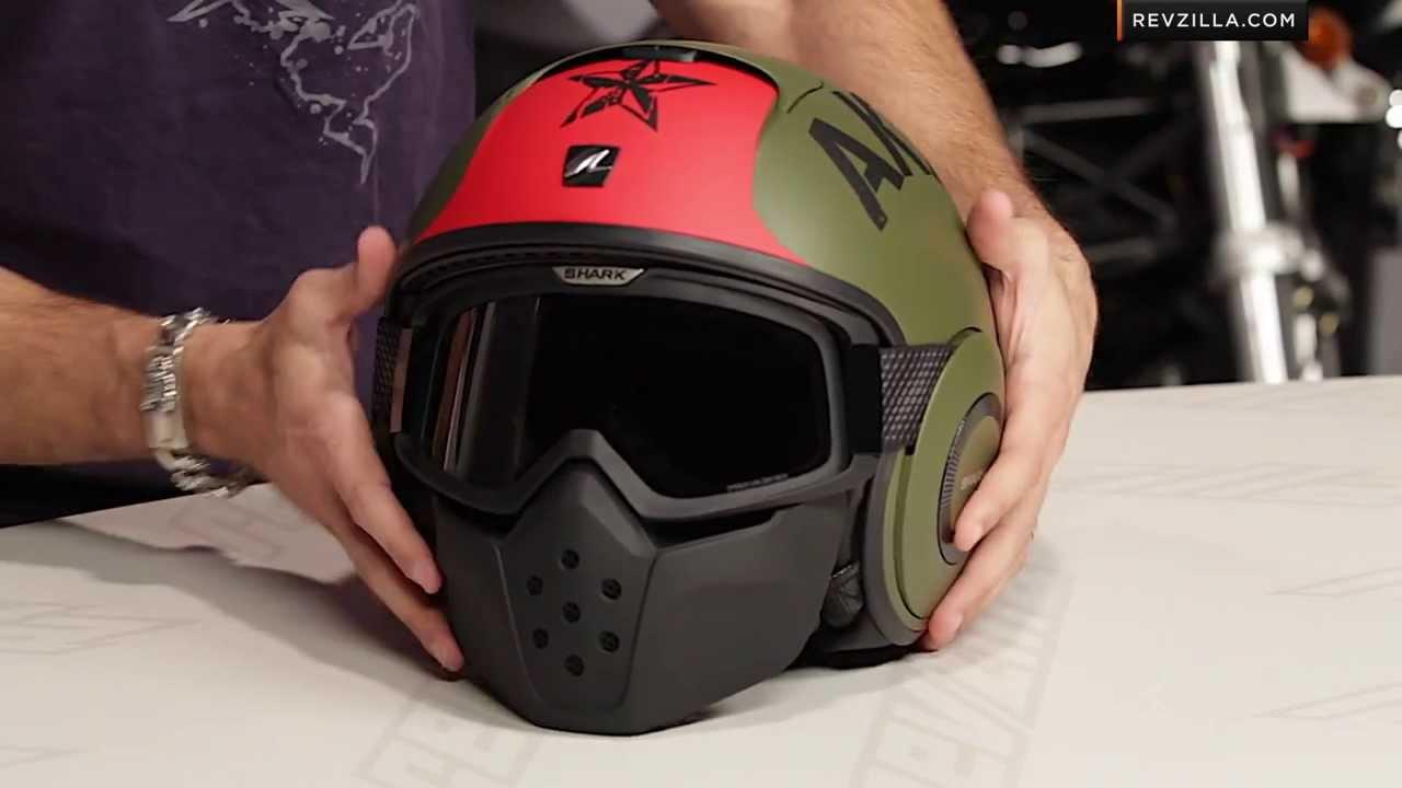 A Motocross Helmet Showing The Elongated Sun Visor And Chin Bar