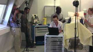 Photographer and models in a medical training simulation environment