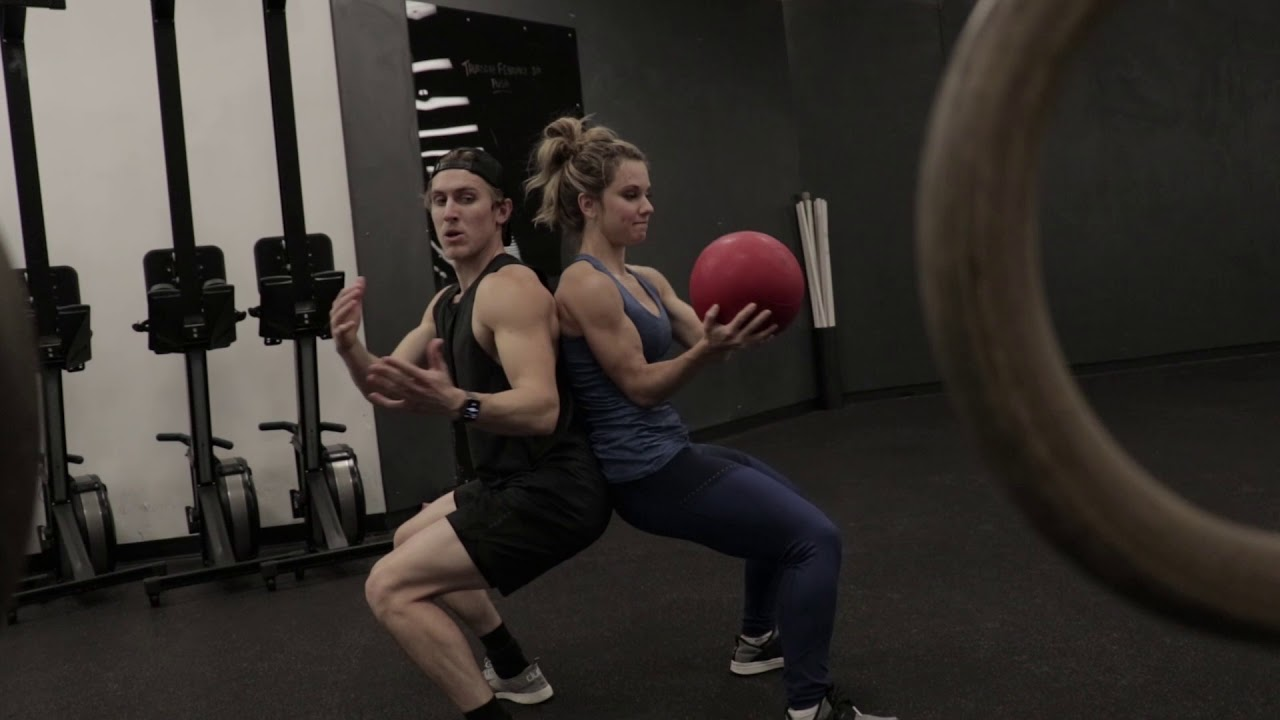 Fitness For Two: Squat With Rotational Medicine Ball Pass