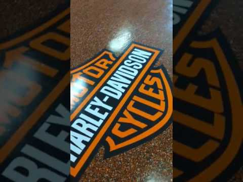 Harley Davidson Epoxy Flake Floor Garage by Paradigm Decorative Concrete and Flooring