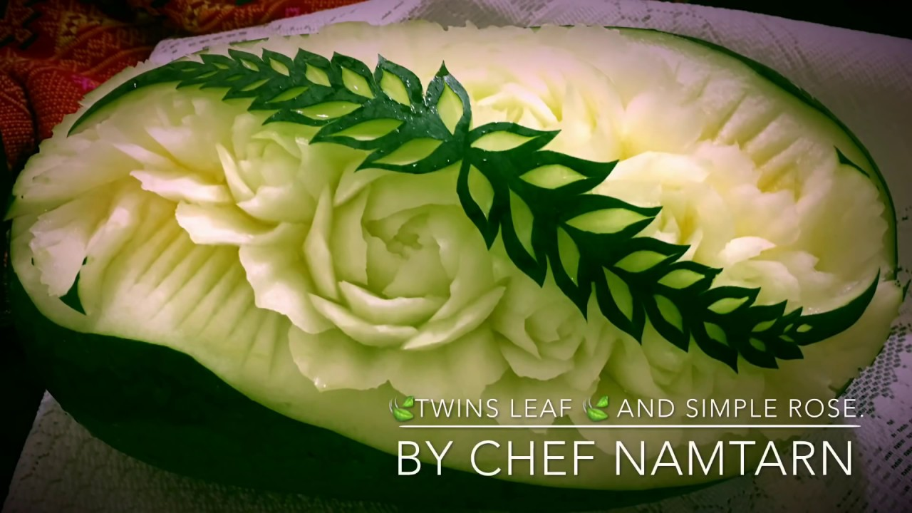 The twins leaf and simple rose in watermelon carving by