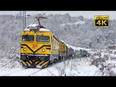 Rail traffic in Serbia - Snowy time south of Belgrade [4K]