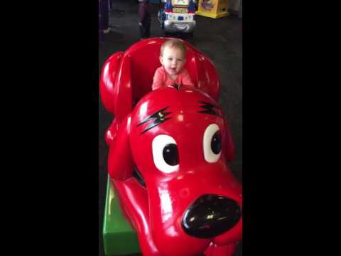 Mia riding on Clifford the Big Red Dog