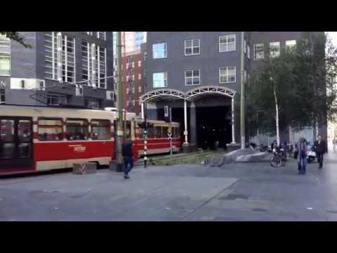 Tram going through building in the Hague, Netherlands