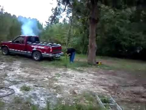 man flies out of truck..Redneck lumberjack pulling down tree