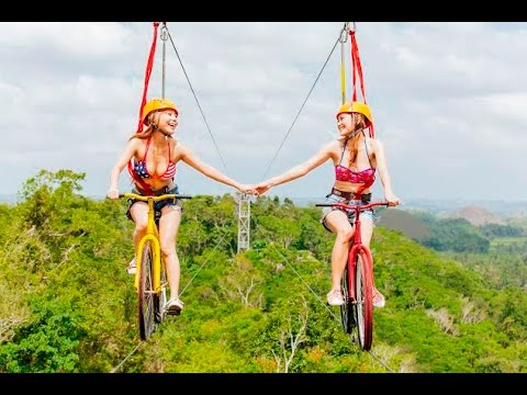 WORLDS FIRST BIKE ZIPLINE. CHOCOLATE HILLS ADVENTURE PARK  BOHOL PHILIPPINES  ADVENTURE   Broadband