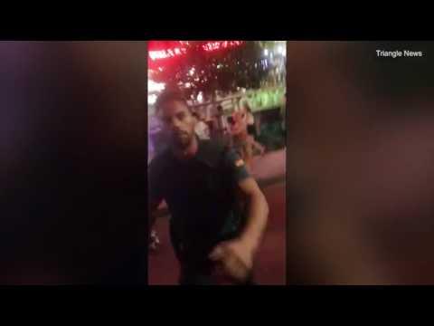 Shocking moment Spanish police beat British tourists with a baton