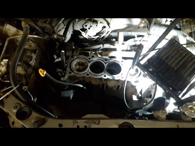 Фото к видео: Ниссан Микра/ Марч 1.4л часть 1я замена поршня,ГБЦ,установка цепи и особенности двигателя CR14de