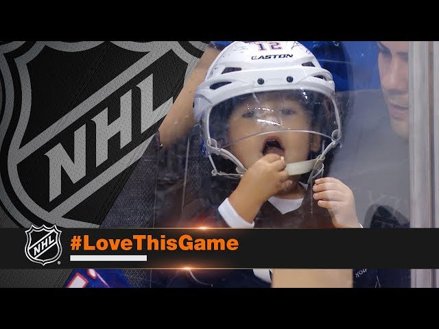 Adorable kid sports Islanders bucket, shares popcorn