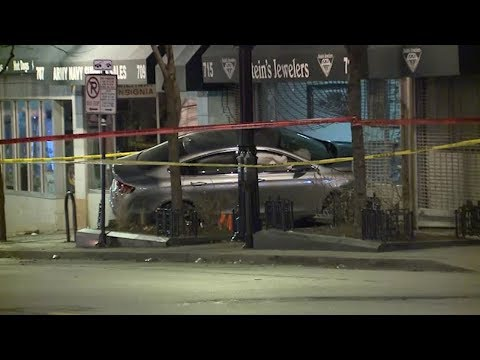 Police: Shots fired at detectives after car crashes into downtown Milwaukee store