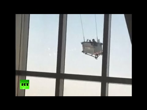 Meanwhile in China: Window cleaning cradle goes mad 91 floors up