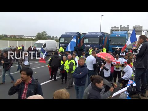 LIVE: Truck drivers block Calais in protest over refugee camp