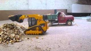 RC Bruder Cat Delta Rubber Tracked Loader stone.wmv