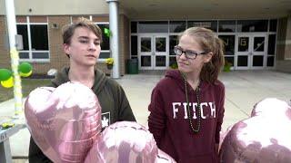 Students honor Illinois teacher who tackled high school gunman