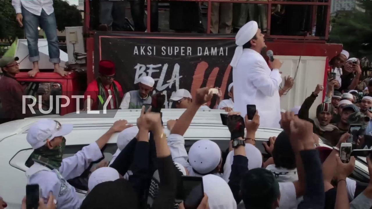 Indonesia fpi leader remains defiant as thousands rally outside indonesia fpi leader remains defiant as thousands rally outside police hq reheart Image collections