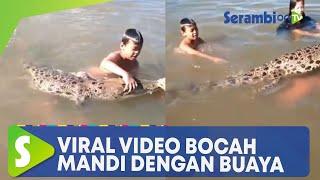 Viral! Video Bocah Mandi dan Bermain dengan Buaya