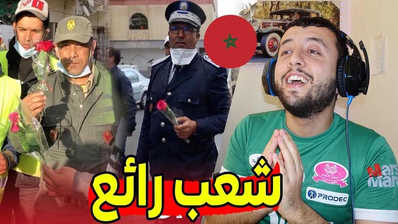 ردة فعل جزائري على سكان كازا الذين رموا الورود لرجال الجيش و الأمن و تأدية النشيد الوطني