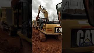 caterpillar 320D excavator working
