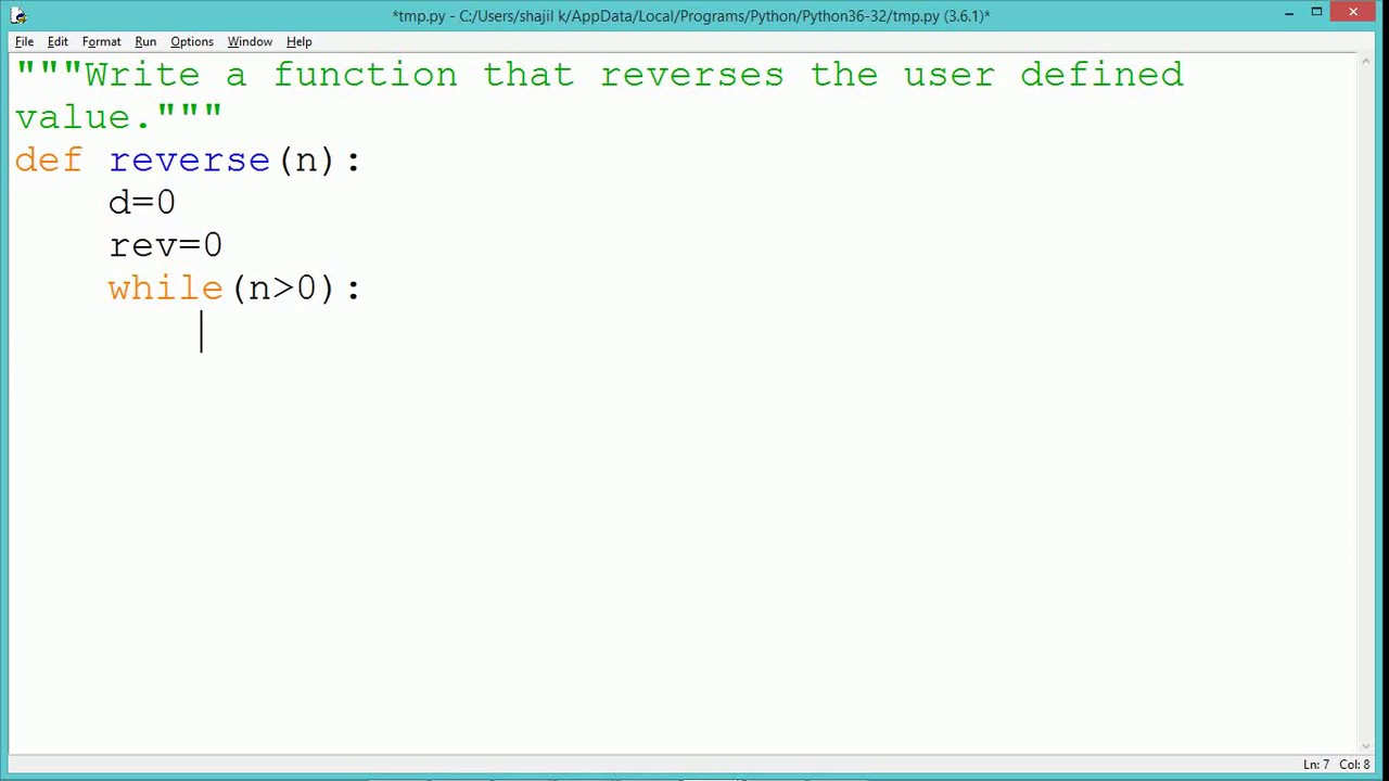 Write a program to reverse a number in python