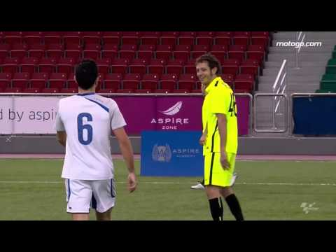 Rossi takes on Barcelona legend Xavi
