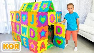 블라드와 니키타는 컬러 플레이 하우스를 재생하고 구축