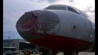 Hailstorm destroys front end of a jet airplane! - IN FLIGHT - #climate #chaos