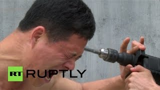 Даже дрель не берет: Шаолиньский монах продемонстрировал необычные способности своего тела(, 2015-03-26T16:16:39.000Z)