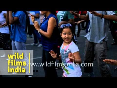 Cute young girl dances fast, catchy and rhythmic Zumba