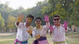 Group of Indian people in white Kurta Pajama wishing Happy Holi - festive scene