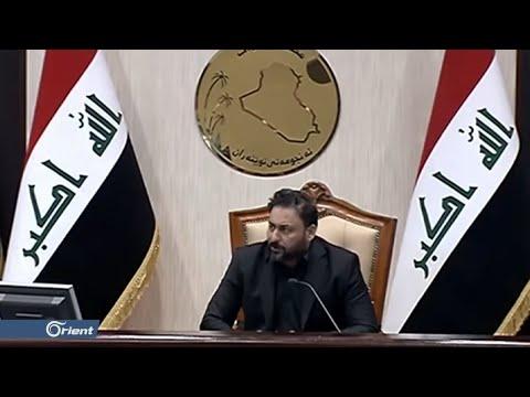 عنصر من قوات حكومة بغداد يهدد المتظاهرين بالذبح