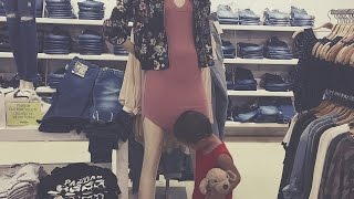 TODDLER BOY CHECKING OUT MANNEQUIN
