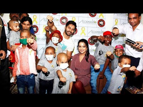 Varun Dhawan spends time with kids suffering from cancer; Watch Video | Filmibeat