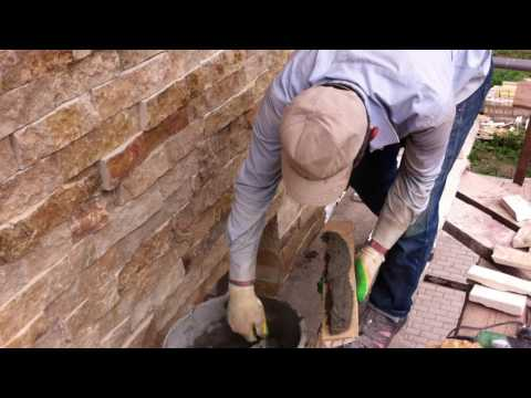 Облицовка фасада камнем.Горный камень скала (доломит).